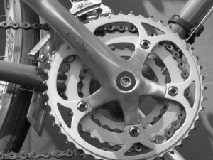 Photo of a triple crankset, one with 3 chainrings