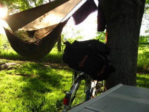 photo of camping bike and hammock