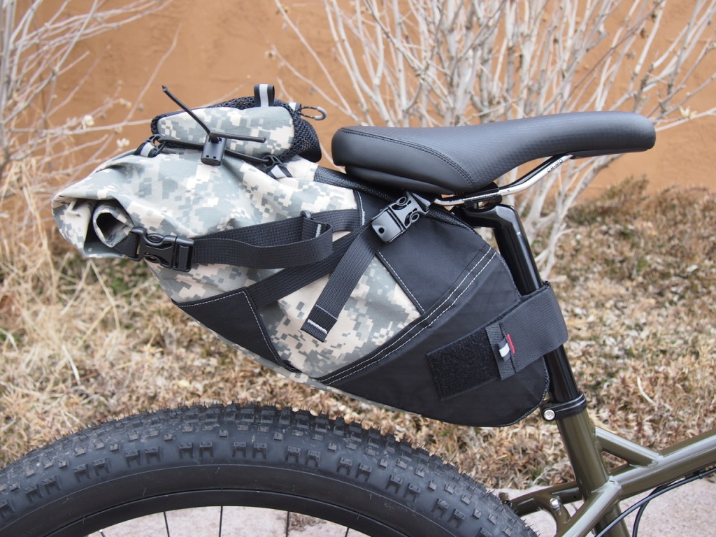 Revelate Viscacha in digital camo with matching Spocket. Photo by the Bike Hermit
