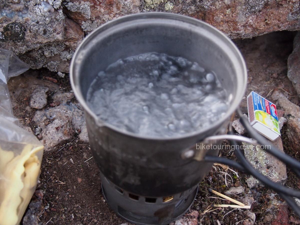 Small pot boiling with alcohol stove