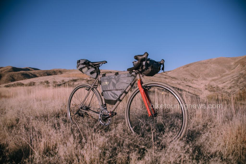 Products pictured: Full Frame Pack (Med.), Handlebar Pack (Dry, 14L), Saddle Pack (Compact)